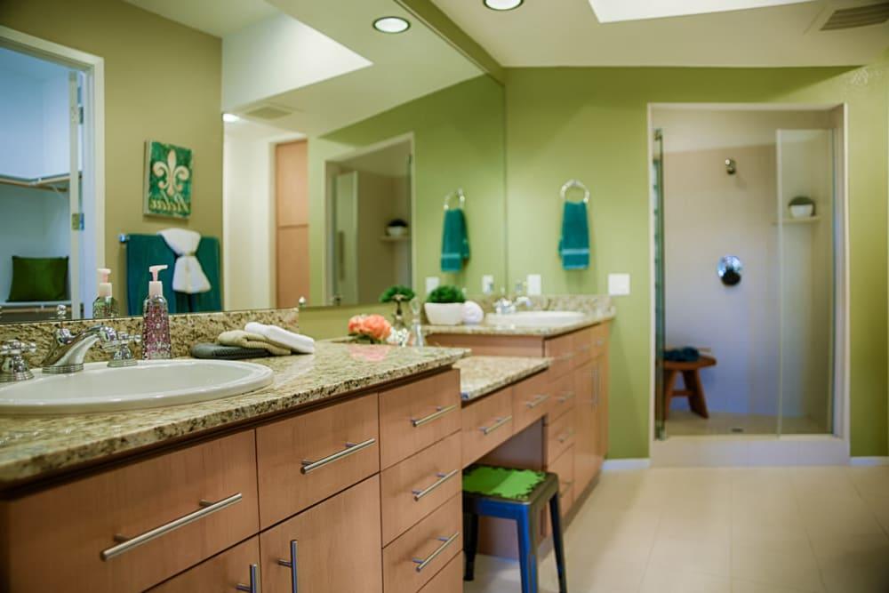Luxury bathroom with green accents at Ten Wine Lofts in Scottsdale, Arizona