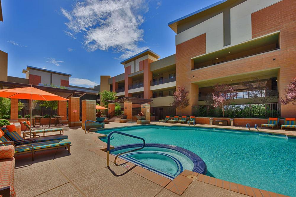 Blue pool and orange umbrellas at Ten Wine Lofts in Scottsdale, Arizona