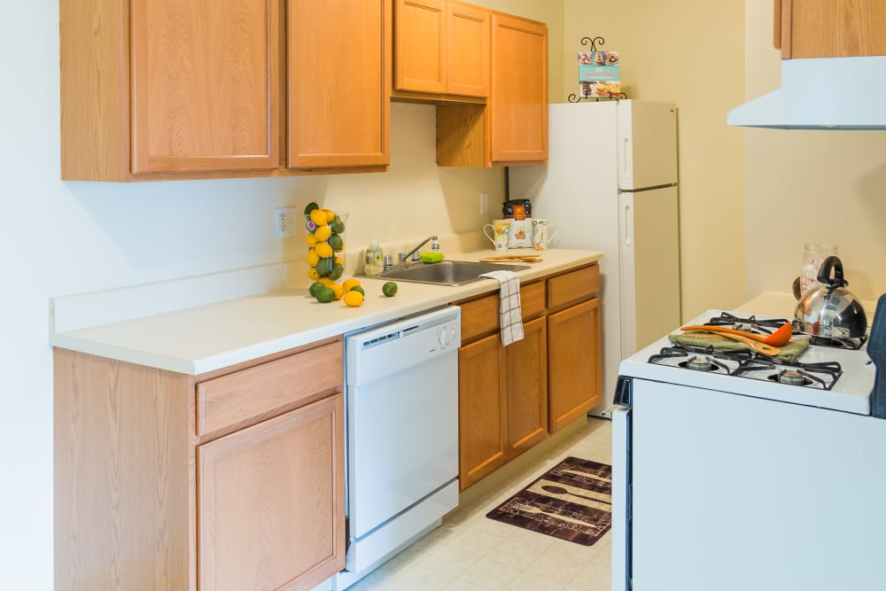 Kitchen with gas stove in Sterling Heights, Michigan at Maple Creek Apartments