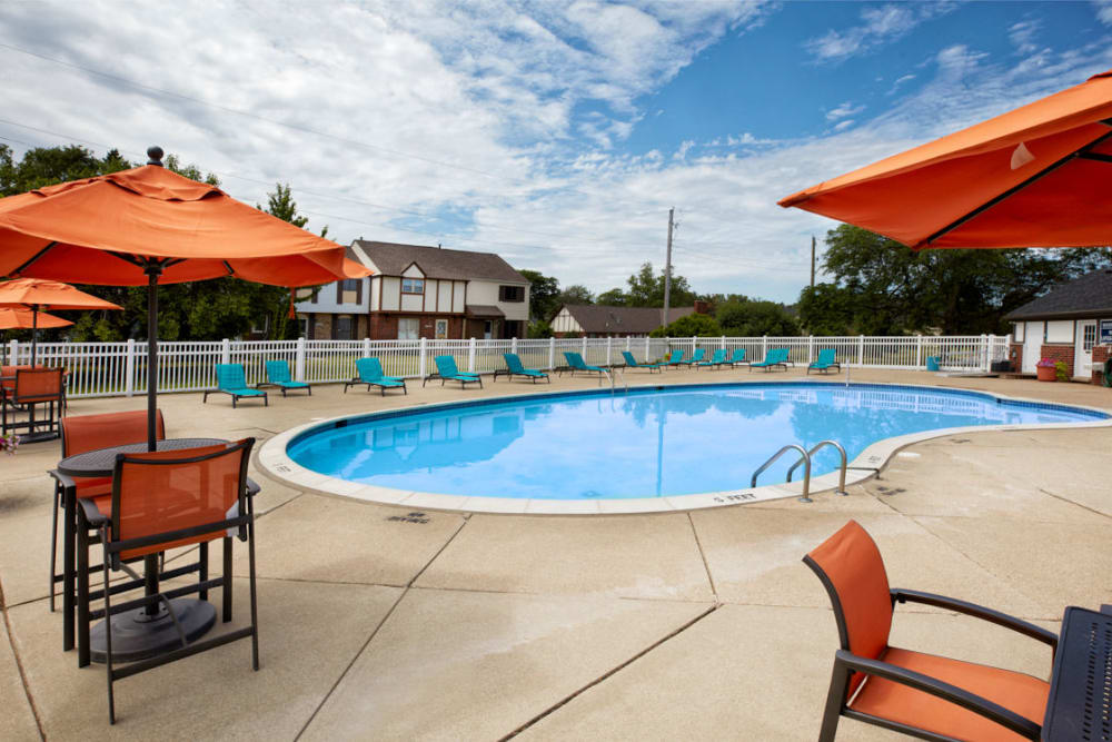 Orange umbrellas next to the pool at Maple Grove Apartments in Sterling Heights, Michigan