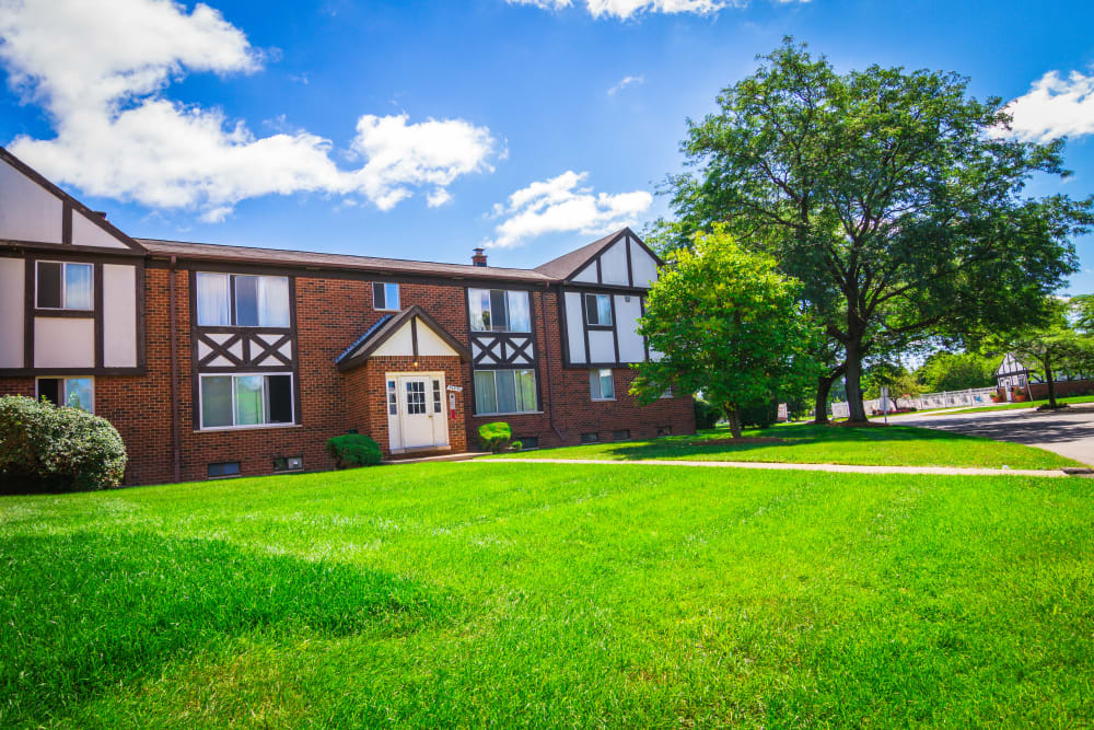Large open grass area at Maple Grove Apartments in Sterling Heights, Michigan