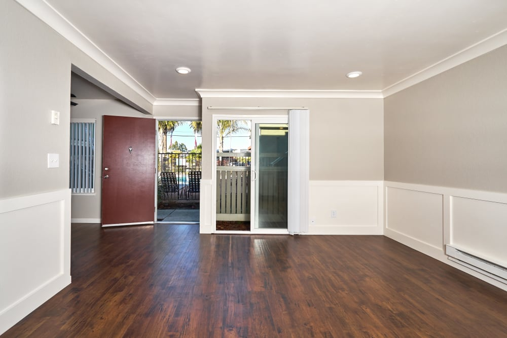 Living room with hardwood floors at Breakwater Apartments in Santa Cruz, California