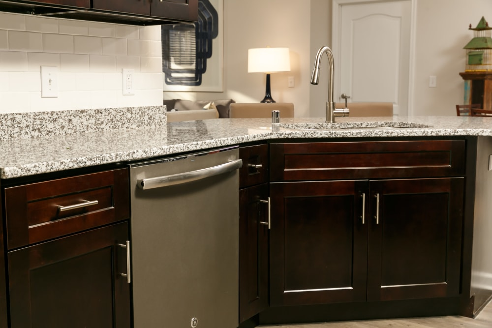 Rich, dark wood cabinetry in model home's kitchen at Valley Farms in Louisville, Kentucky