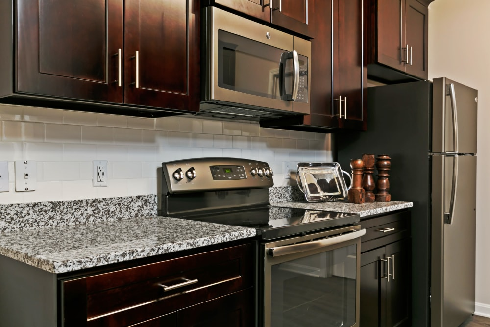 Granite countertops and stainless-steel appliances in a model home's kitchen at Valley Farms in Louisville, Kentucky