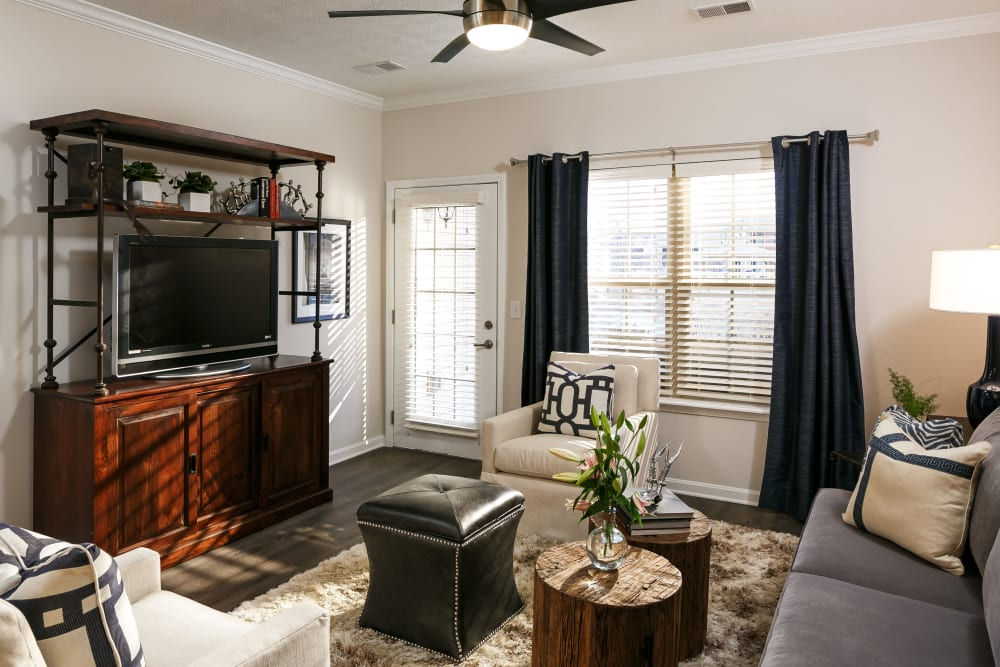 Ceiling fan and large windows in the living area of a model home at Valley Farms in Louisville, Kentucky