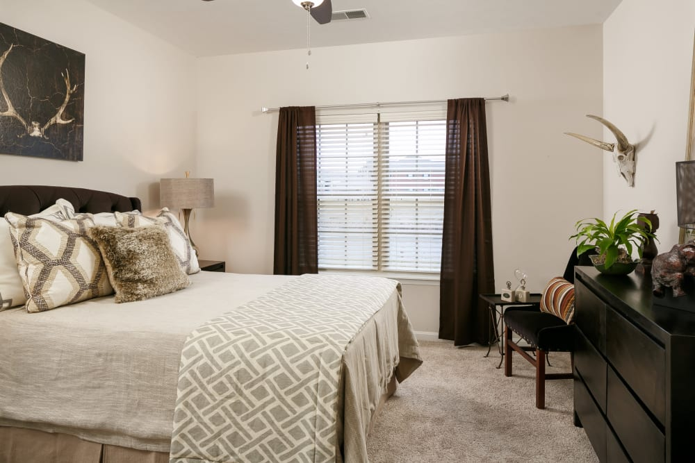 Beautifully decorated master bedroom in a model home at Valley Farms in Louisville, Kentucky