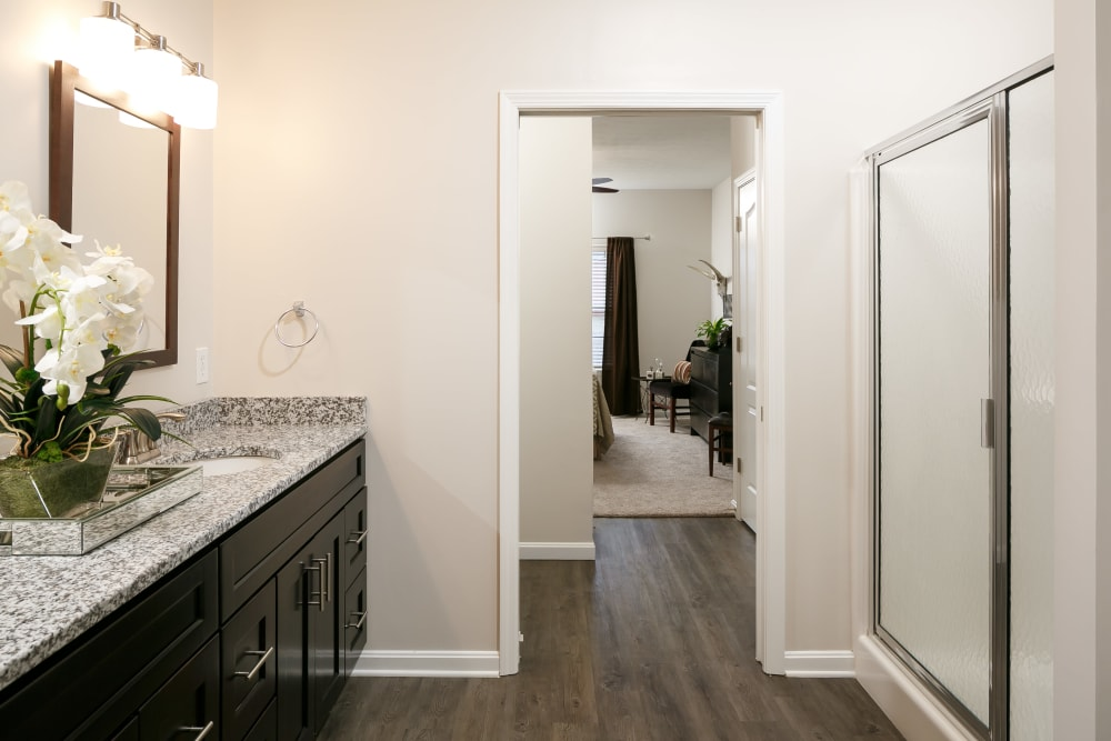 Hardwood floors and granite countertops in a model home's bathroom at Valley Farms in Louisville, Kentucky