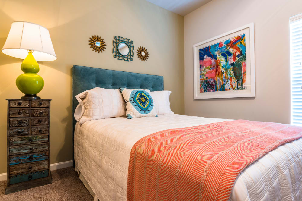 Bright and cheerfully decorated guest room in a model home at Valley Farms in Louisville, Kentucky