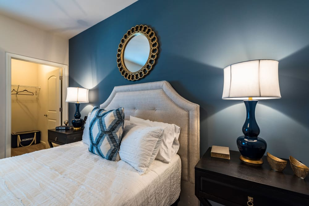 Classically decorated master bedroom with an accent wall in a model home at Valley Farms in Louisville, Kentucky