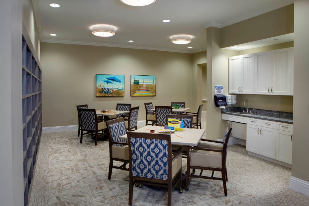 Small dining room and community kitchen at Beach House Assisted Living & Memory Care Naples in Naples, Florida