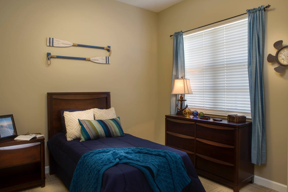 Marina themes bedroom at Beach House Assisted Living & Memory Care Naples in Naples, Florida