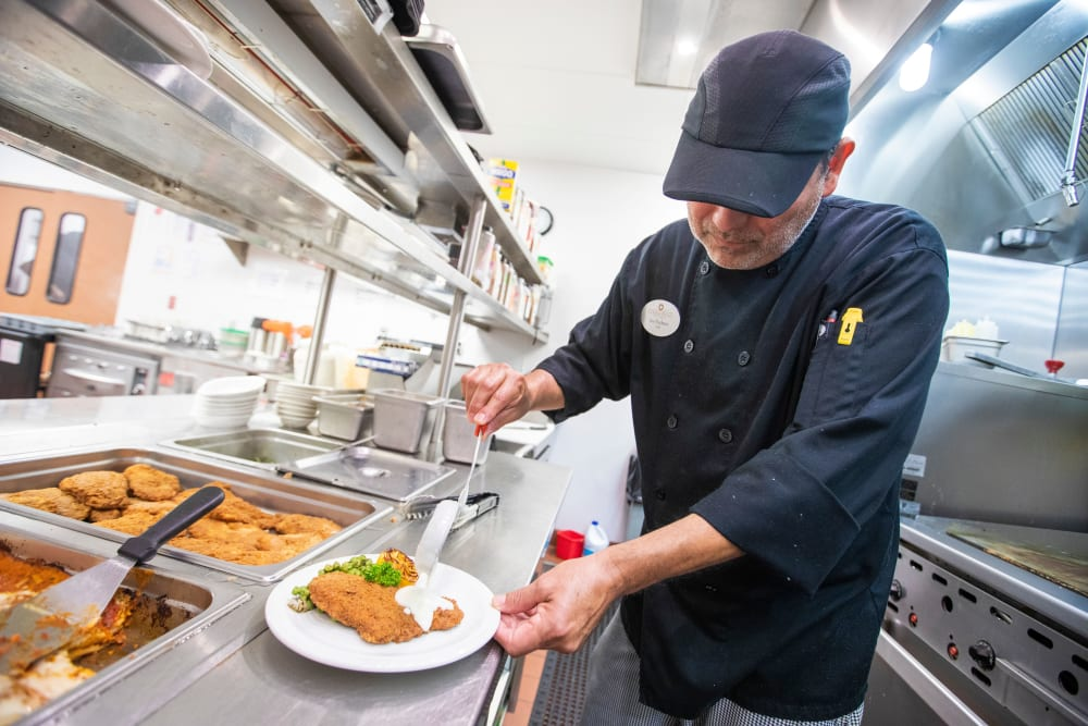 Chef preparing dish at Cypress Point in Fort Myers, Florida