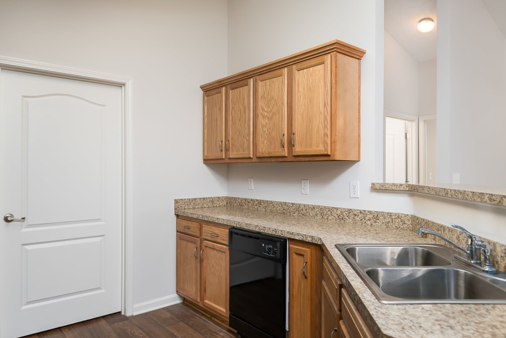 Gourmet kitchen with black appliances in an apartment home's kitchen at Valley Farms in Louisville, Kentucky
