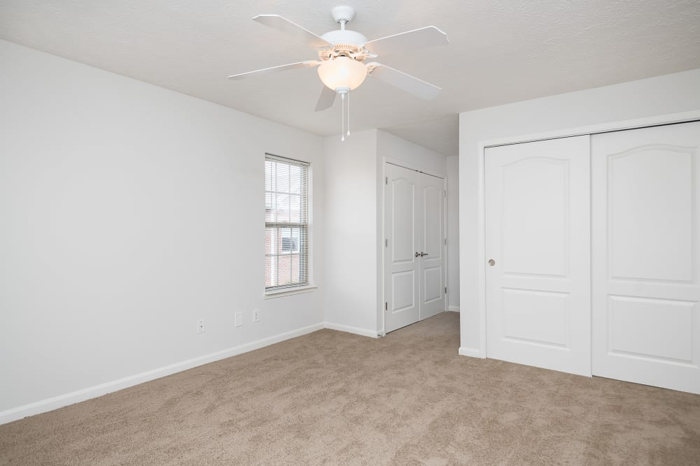 Ceiling fan and plush carpeting in an apartment home at Valley Farms in Louisville, Kentucky