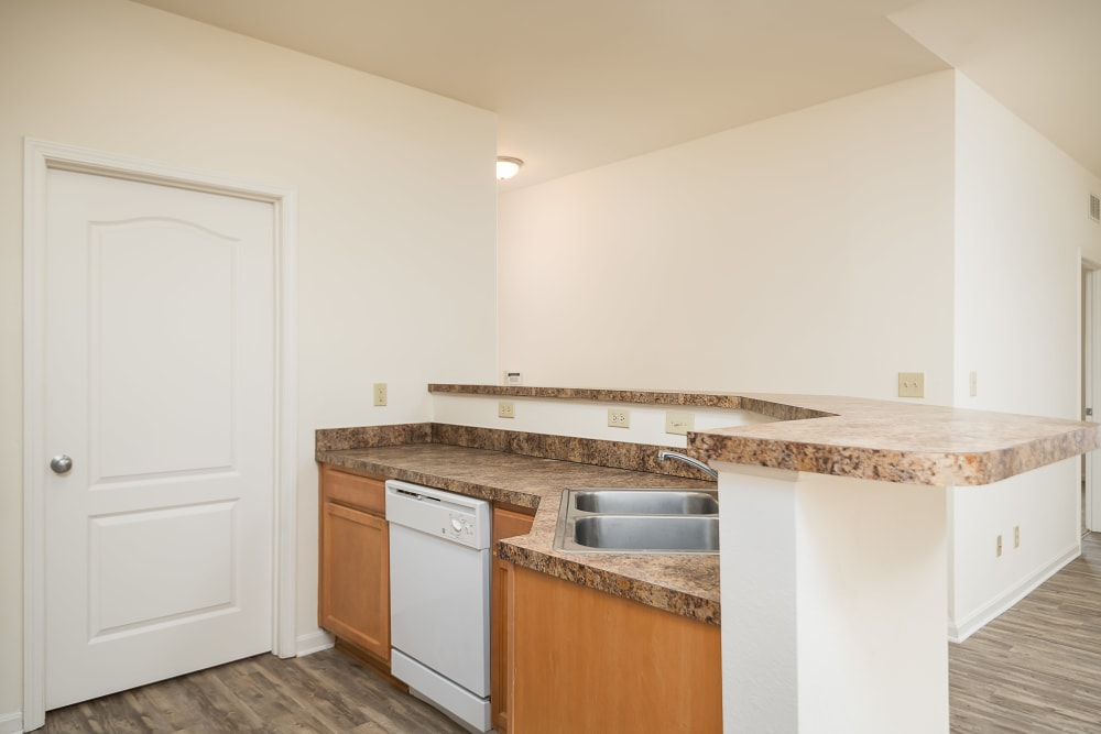 Light-colored wood cabinetry in an apartment home's kitchen at Valley Farms in Louisville, Kentucky