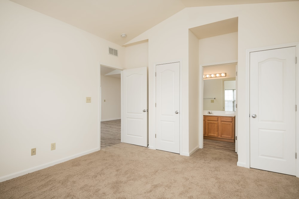 Plush carpeting and an en suite bathroom in an apartment home at Valley Farms in Louisville, Kentucky