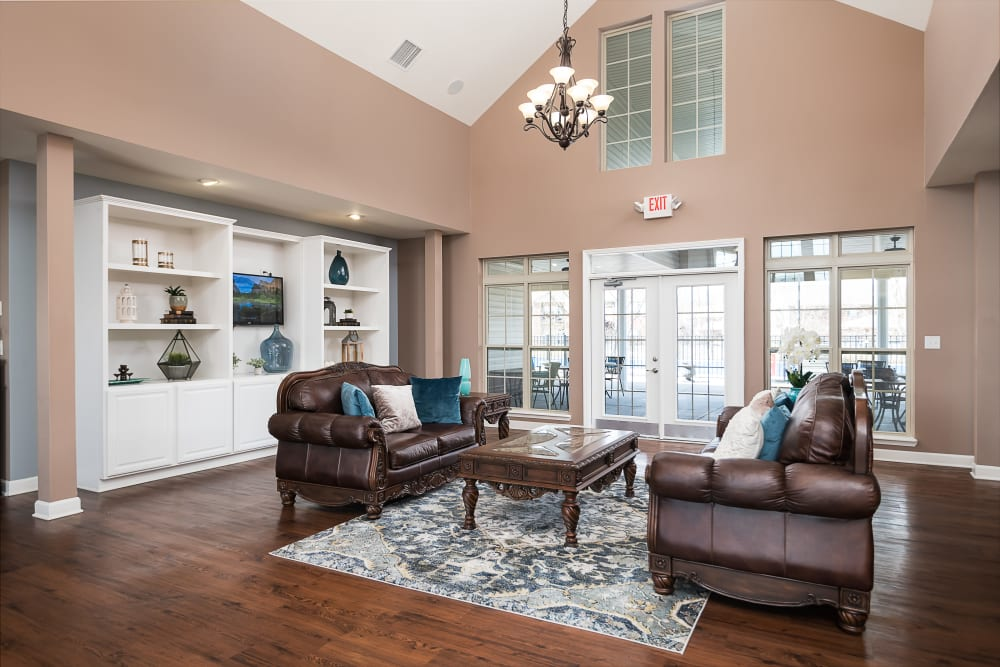 Accent wall and cozy seating arrangement in the clubhouse at Valley Farms in Louisville, Kentucky
