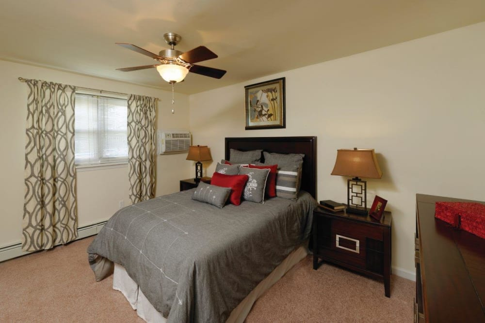 Bedroom with a ceiling fan at Hill Brook Place Apartments in Bensalem, Pennsylvania