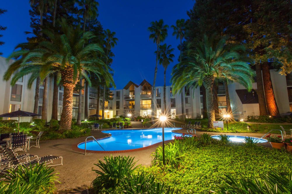 Castlewood Apartments' sparkling pool at night in Walnut Creek, California