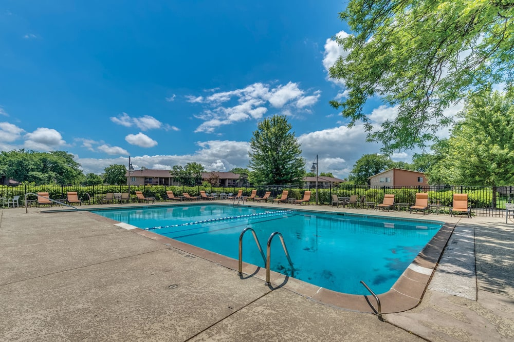 Pool and deck chairs outside Lakeside Apartments in Lisle, Illinois