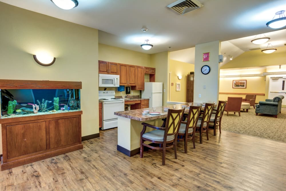 A fish tank next to the kitchen at Rosewood Memory Care in Hillsboro, Oregon