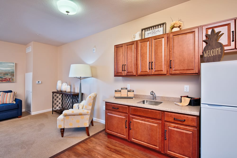 Resident living room and kitchen at The Fountains of Hope in Sarasota, Florida.