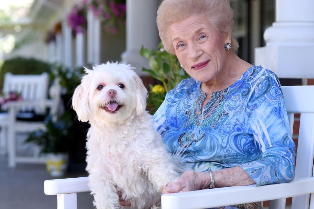 Senior with dog on lap