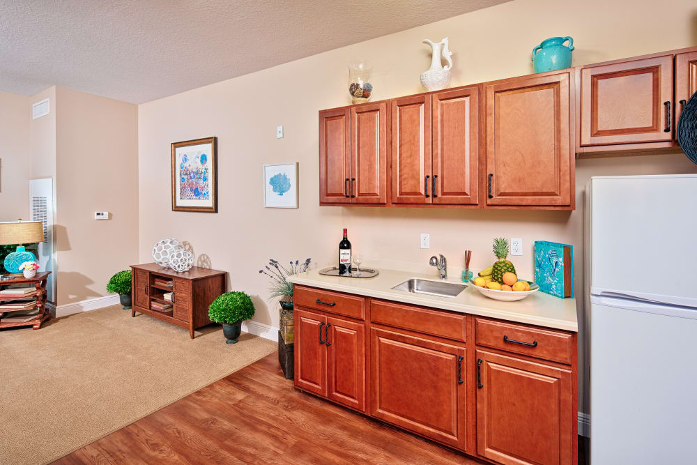 A resident kitchen and living room at The Springs At South Biscayne in North Port, Florida.