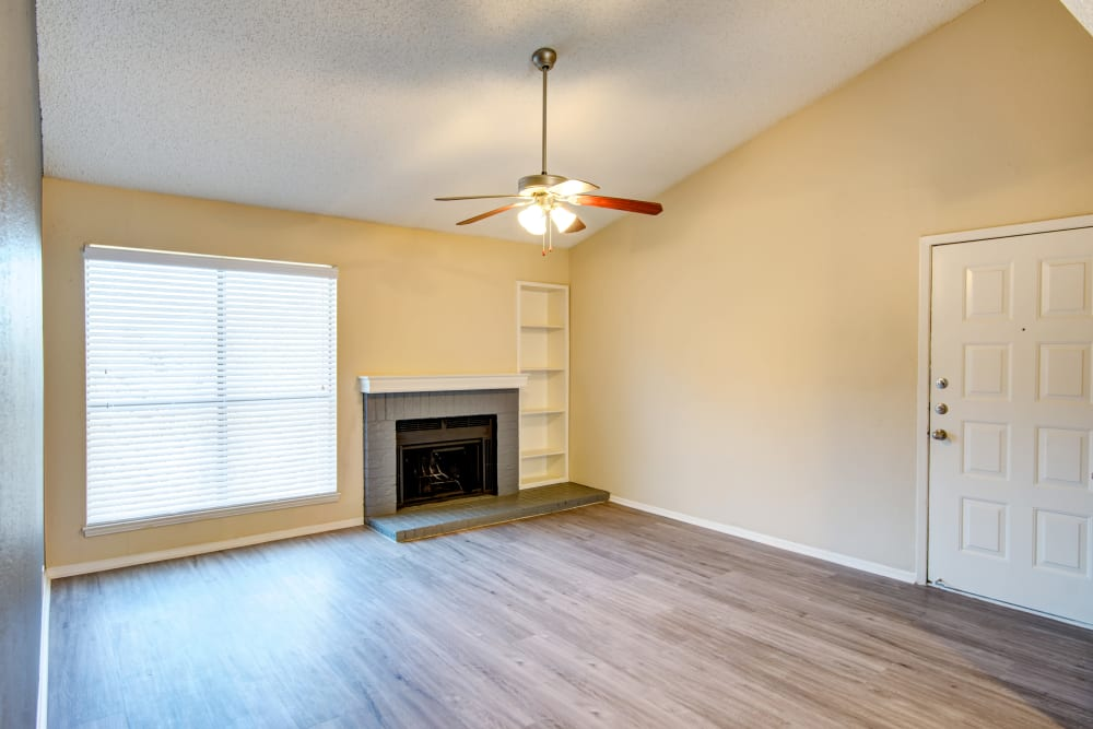 Hardwood floors and a fireplace in an apartment home at Grayson Ridge in North Richland Hills, Texas