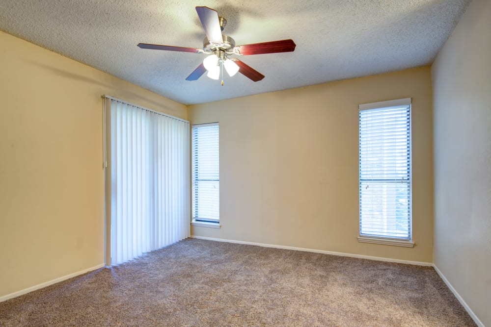 Plush carpet and a ceiling fan in an apartment home's bedroom at Grayson Ridge in North Richland Hills, Texas