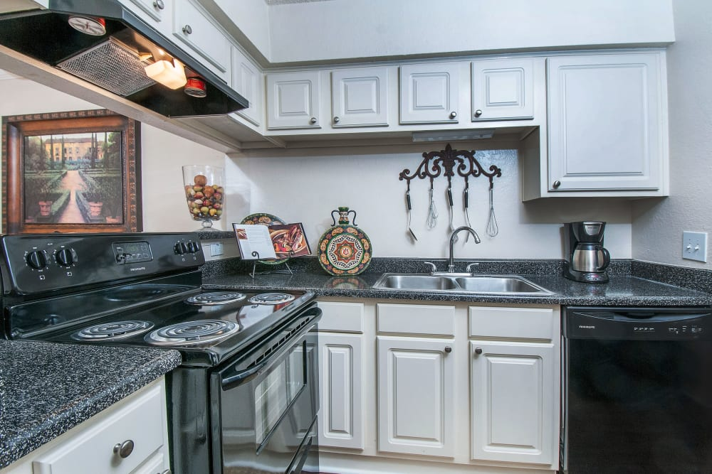 Granite countertops and plenty of storage space in a model home's gourmet kitchen at Grayson Ridge in North Richland Hills, Texas