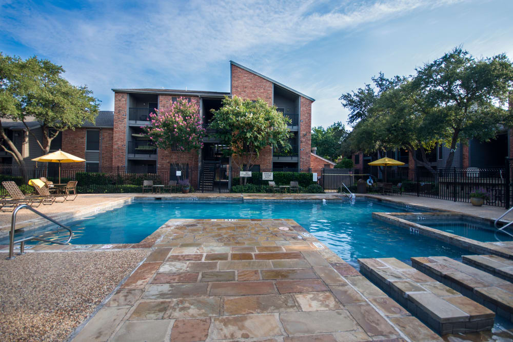Ceramic tile sun deck surrounding the pool at Grayson Ridge in North Richland Hills, Texas