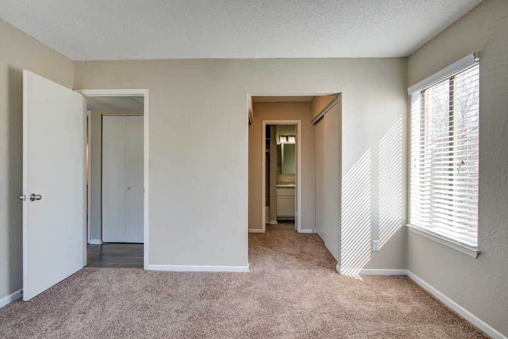 Large master bedroom with a closet and bathroom at The Belmont in Grand Prairie, Texas