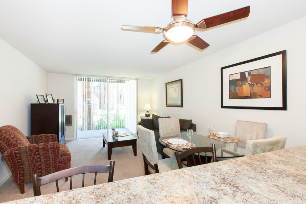 Living room with a ceiling fan at Castlewood Apartments in Walnut Creek, California