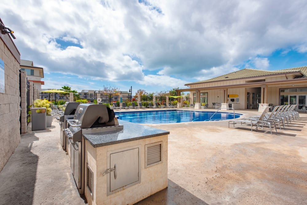 Pool area with barbecue's at Kapolei Lofts