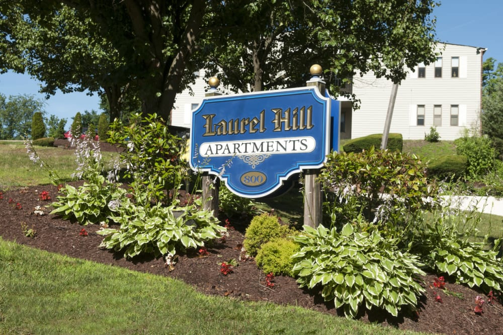 Apartment sign surrounded by a beautifully manicured landscape at Laurel Hill Apartments in Lindenwold, New Jersey