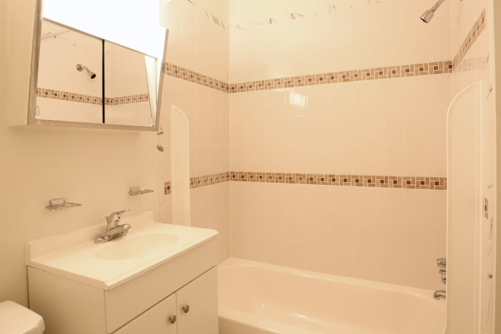 Beautiful bathroom with a tile back splash at Laurel Hill Apartments in Lindenwold, New Jersey