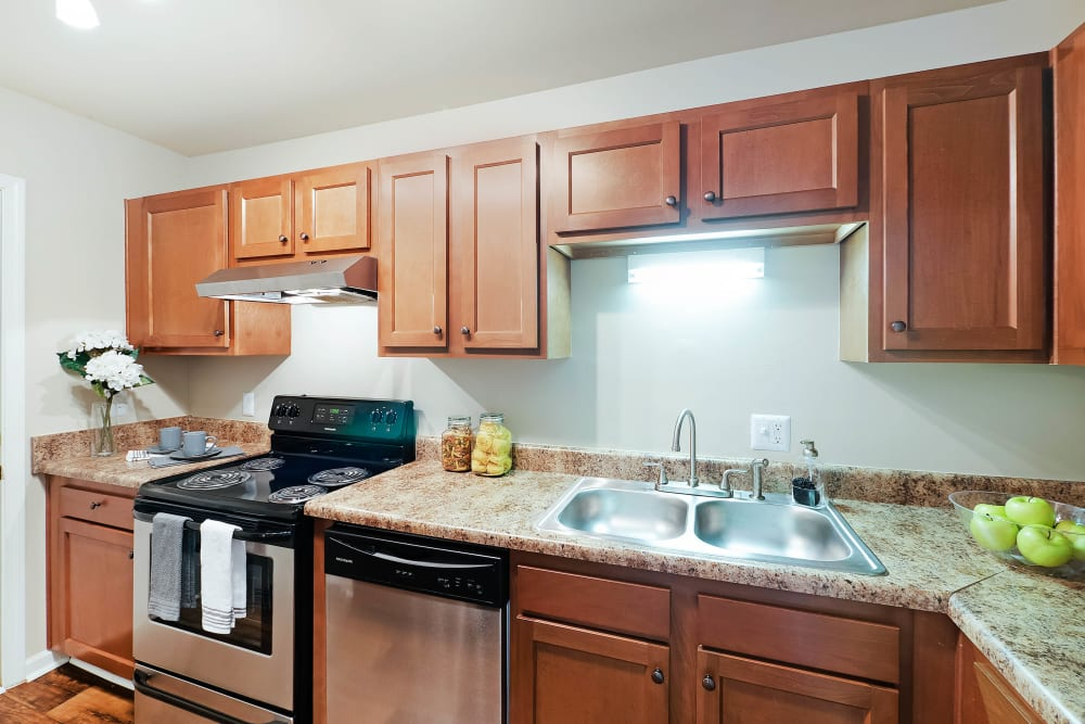 Kitchen with stainless steel appliances at Redmond Chase Apartments in Rome, Georgia.