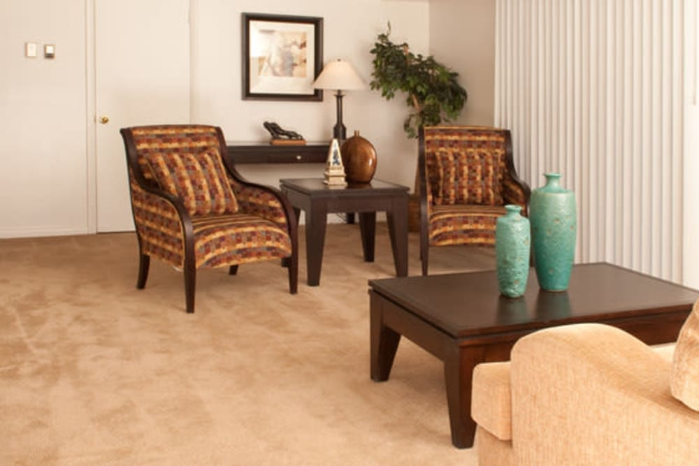 Spacious living room with plush carpeting at Chadwick Village Apartments in Lindenwold, New Jersey