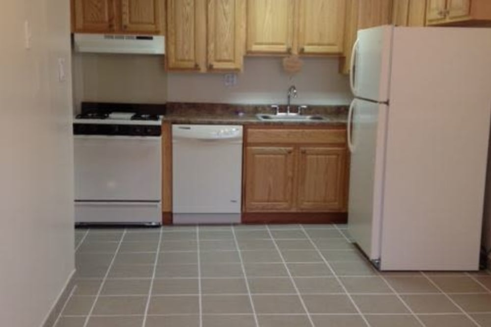 Large kitchen with an electric stove top at Chadwick Village Apartments in Lindenwold, New Jersey