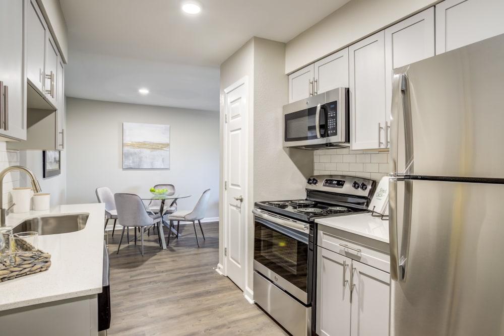 Kitchen at Villages at Parktown Apartments in Deer Park, Texas