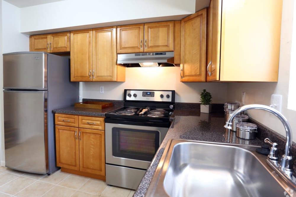 Large kitchen with stainless-steel appliances at Orchard Hills Apartments in Whitehall, Pennsylvania