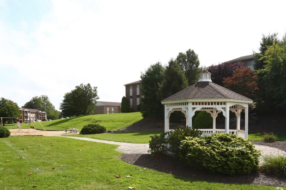 Manicured lawn with a gazebo at Orchard Hills Apartments in Whitehall, Pennsylvania