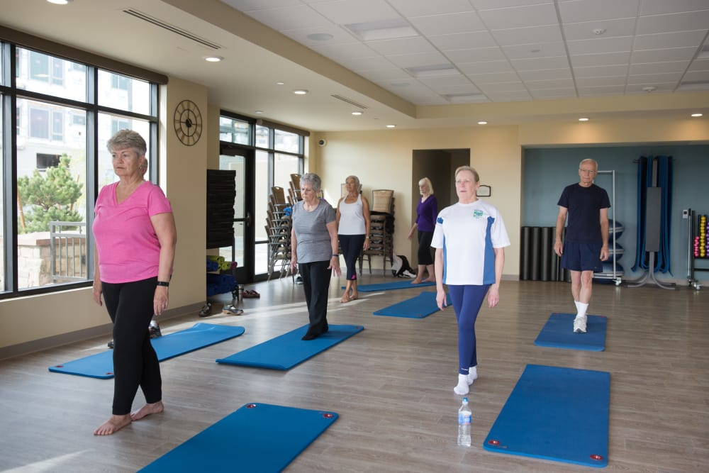 Residents beside yoga mats at Touchmark Health & Fitness Club in Meridian, Idaho
