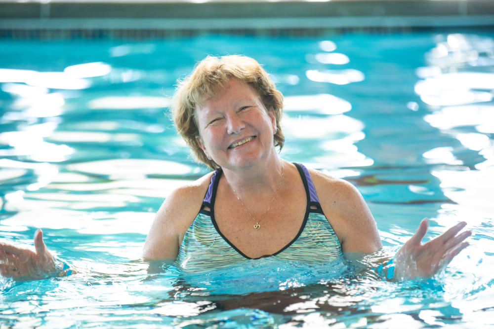 A happy resident in the pool at Touchmark Health & Fitness Club in Meridian, Idaho