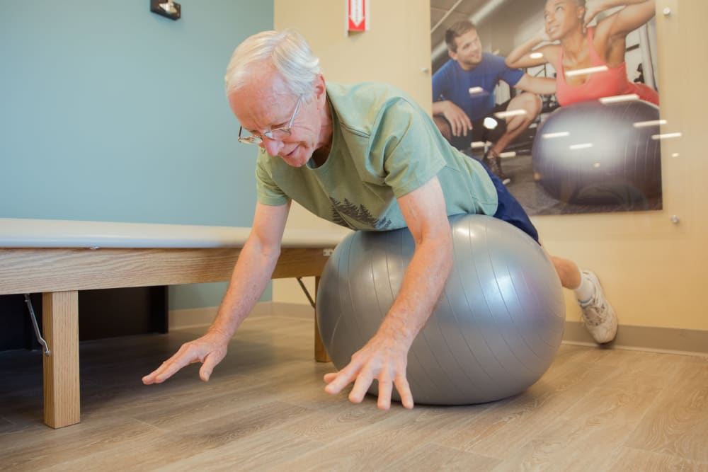 A resident on a yoga ball at Touchmark Health & Fitness Club in Meridian, Idaho