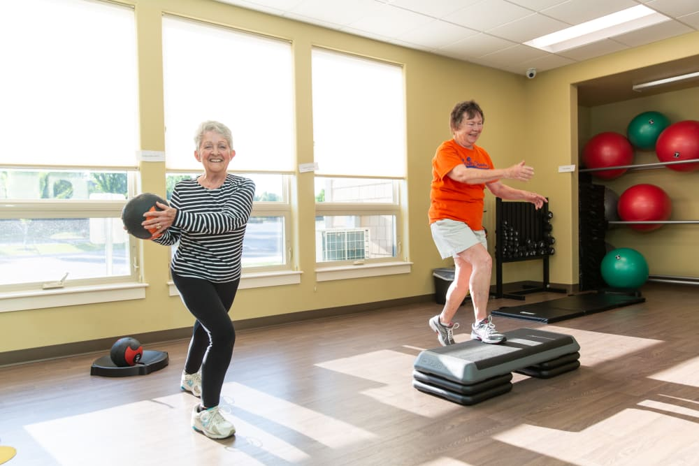 Two residents exercising at Touchmark Health & Fitness Club in Meridian, Idaho