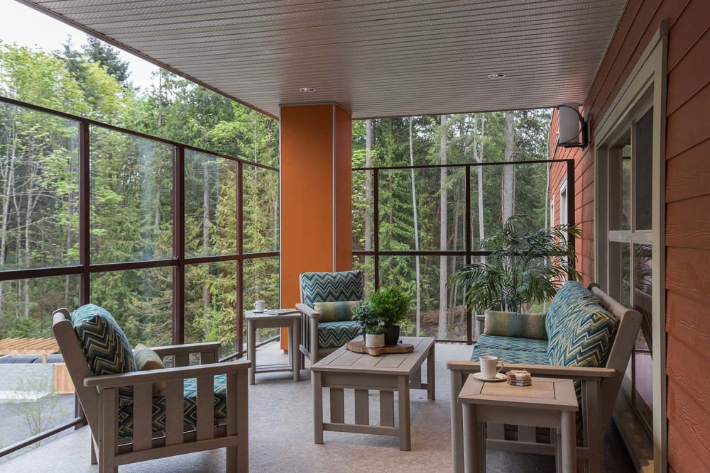 Seating with a beautiful view at Avenir Memory Care at Nanaimo in Nanaimo, British Columbia