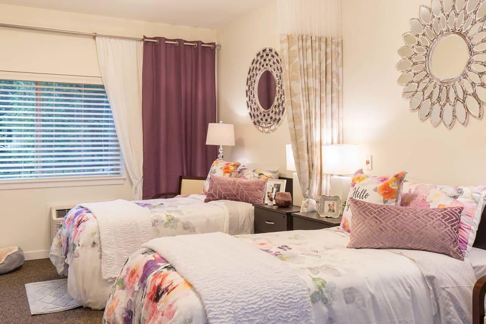 A beautiful bedroom at Avenir Memory Care at Nanaimo in Nanaimo, British Columbia