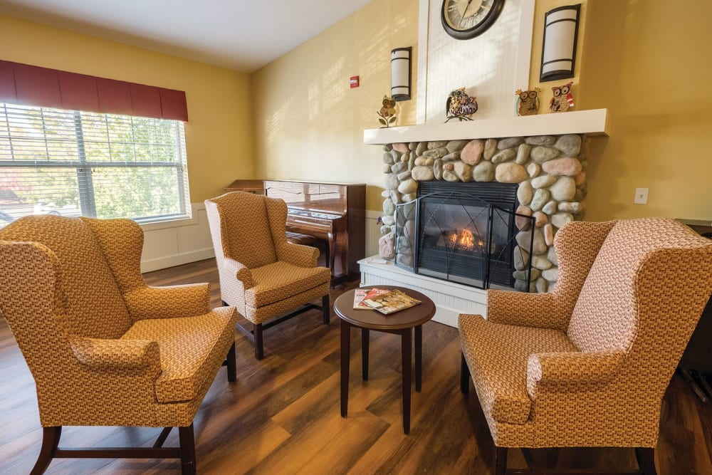 Some comfortable chairs arranged by a fireplace at Lakeland Senior Living in Eagle Point, Oregon